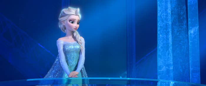 Elsa standing alone in her ice castle