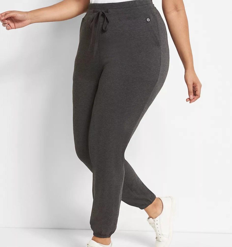 Model wearing grey joggers