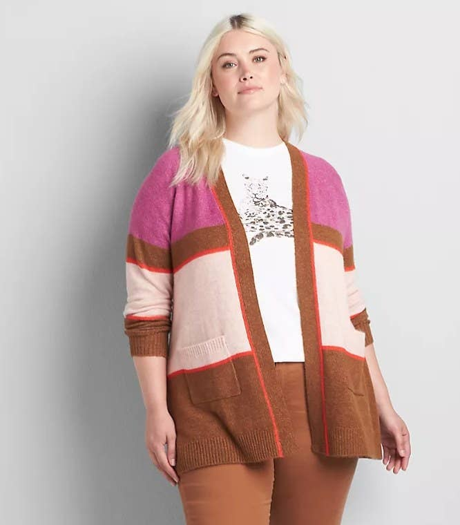 Model wearing brown, white and pink color block sweater