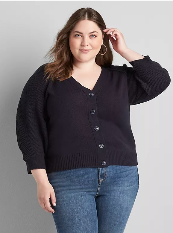 Model wearing navy button up cardigan