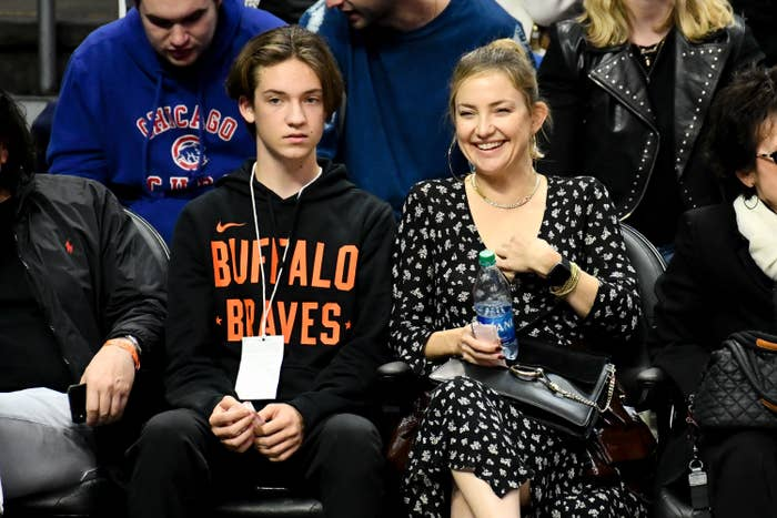 Kate sitting at a sporting event with her son