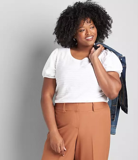 Model wearing white tee and brown pants