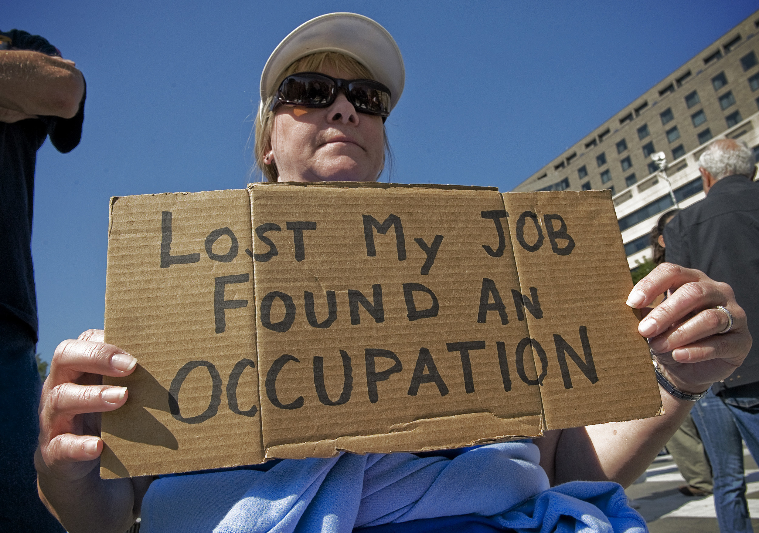 """Sign reads """"lost my job found an occupation"""""""