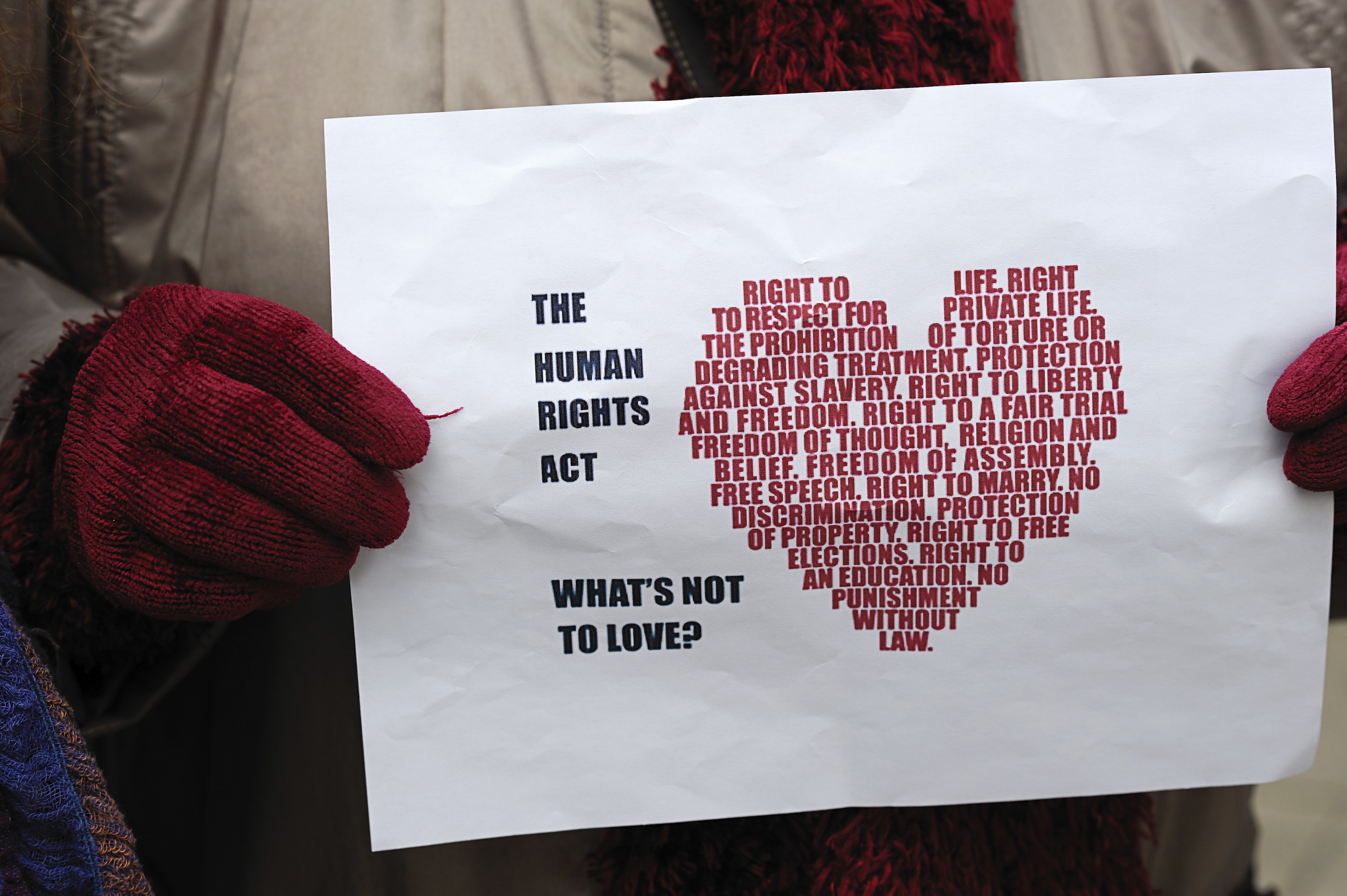 Sign shows a heart with text referencing the Human Rights Act