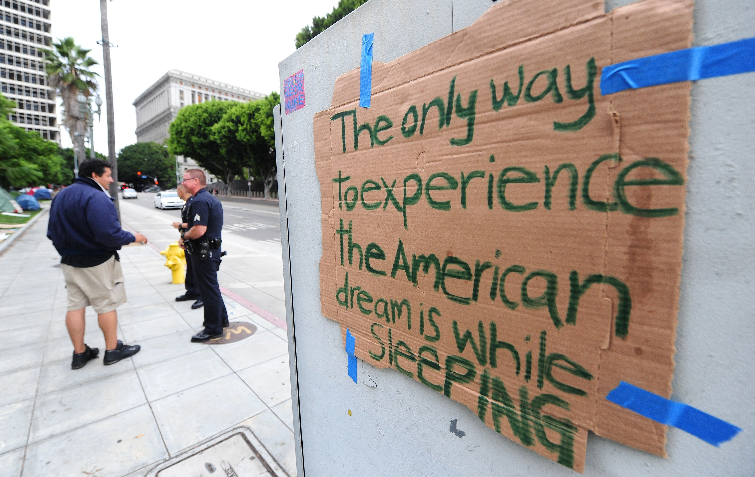 """A sign reads """"the only way to experience the American dream is while sleeping"""""""