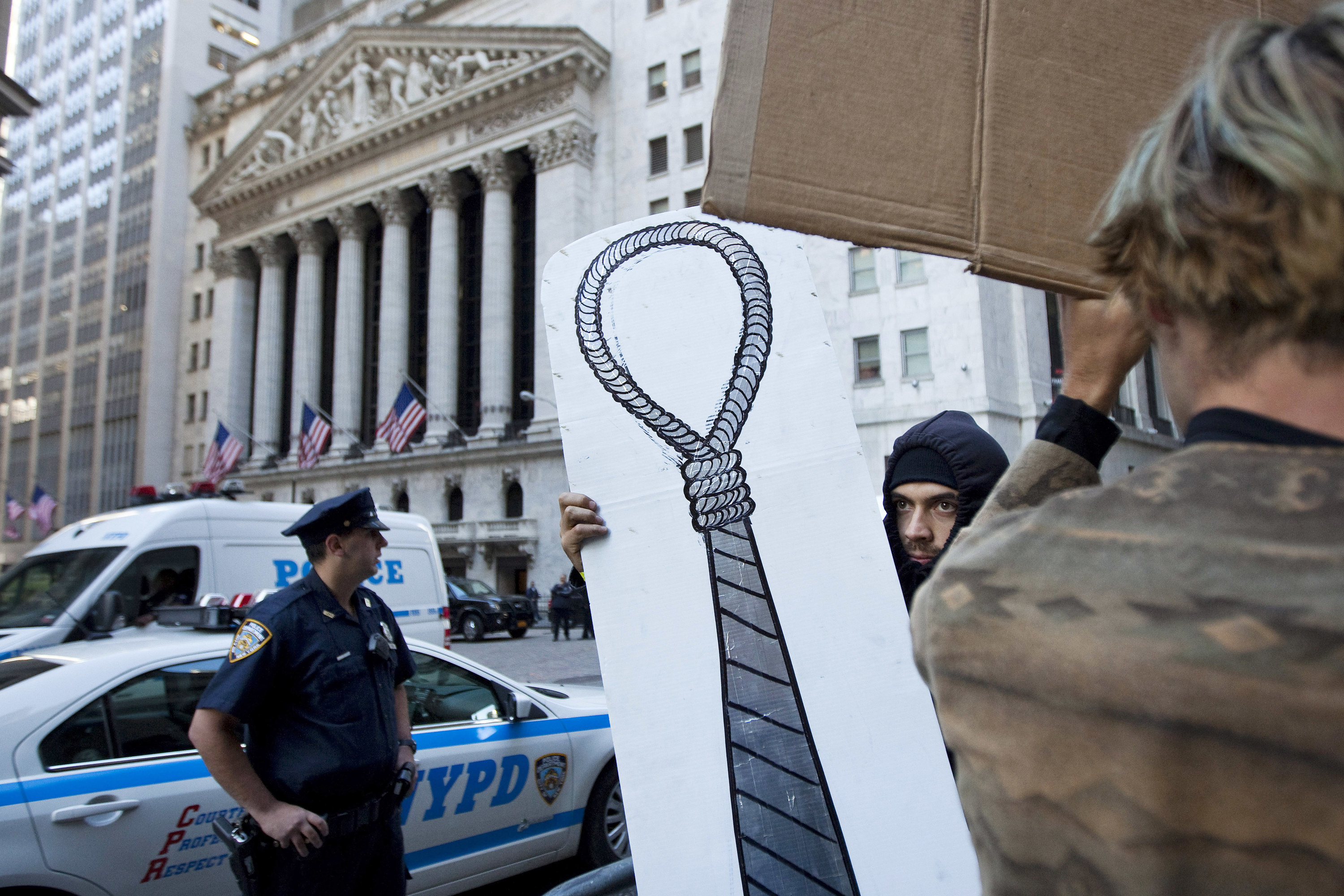 The sign is a drawing of a noose turned into a necktie