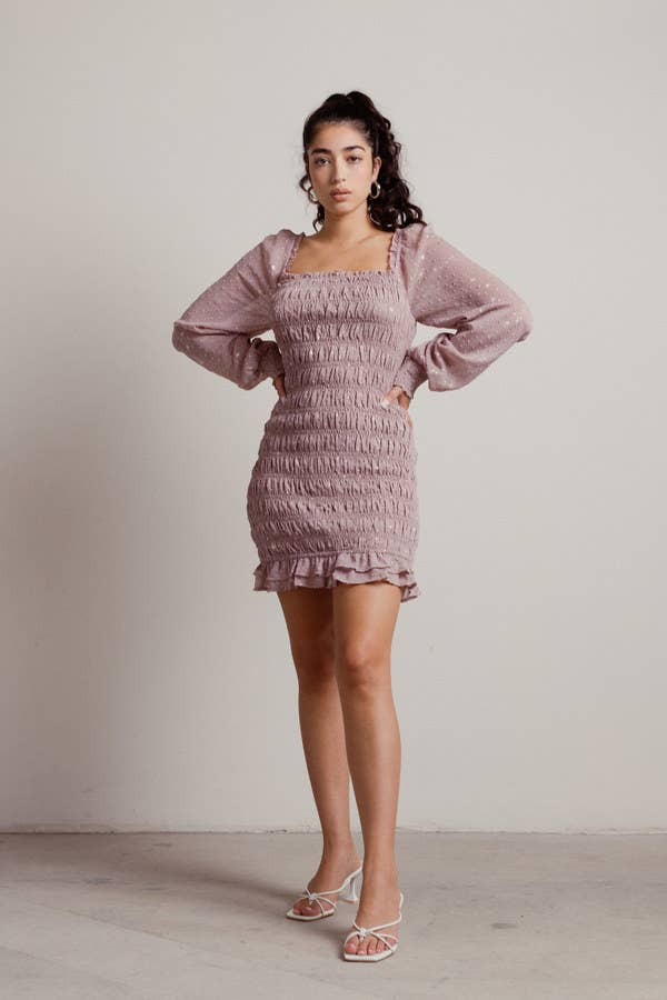 model wearing the dress in light pink