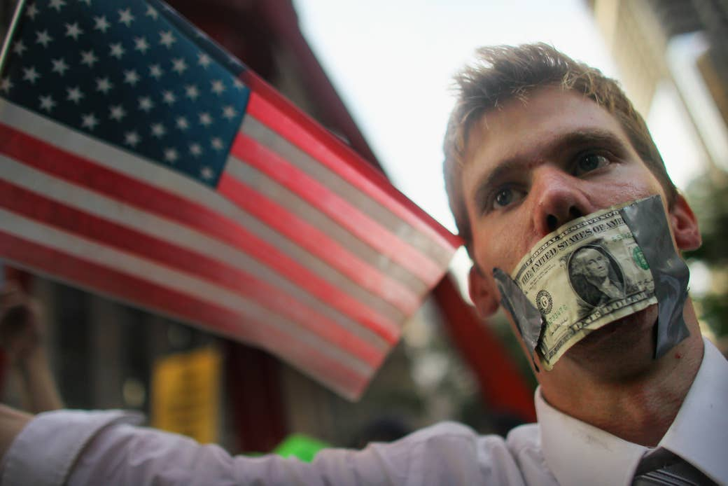 A protester wears a dollar bill over his mouth