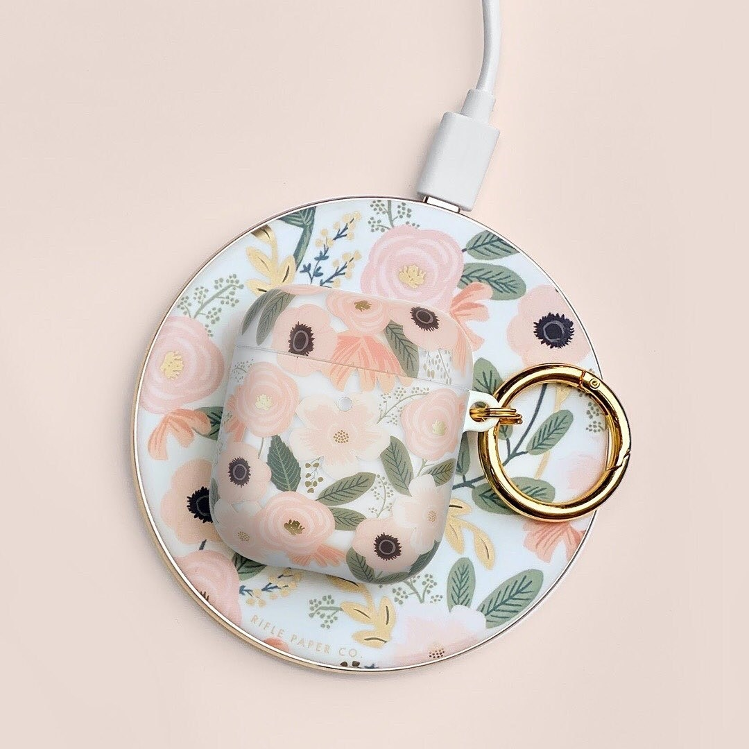 a pink floral rounded charging dock