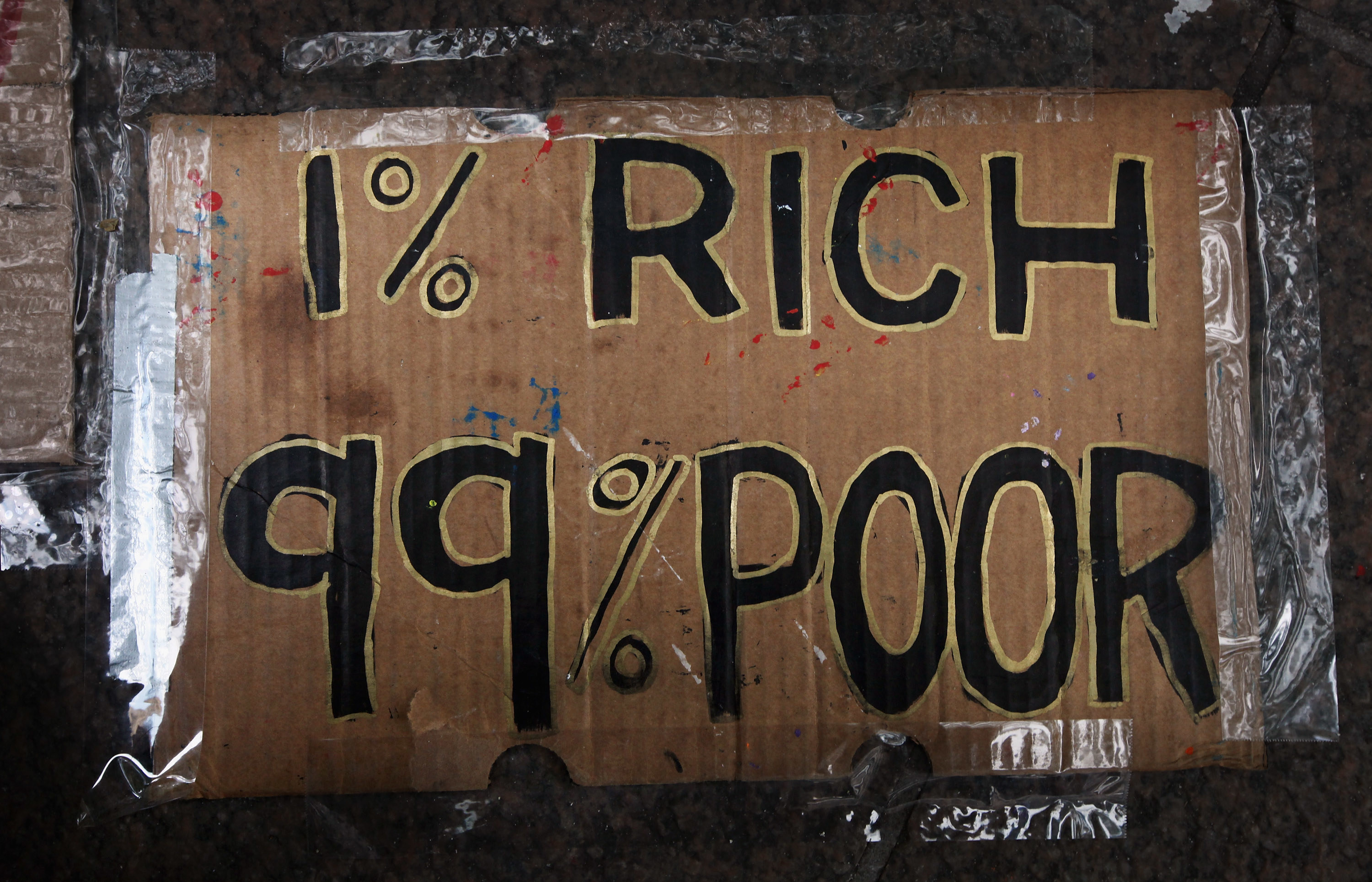 Sign reads 1% Rich 99% Poor