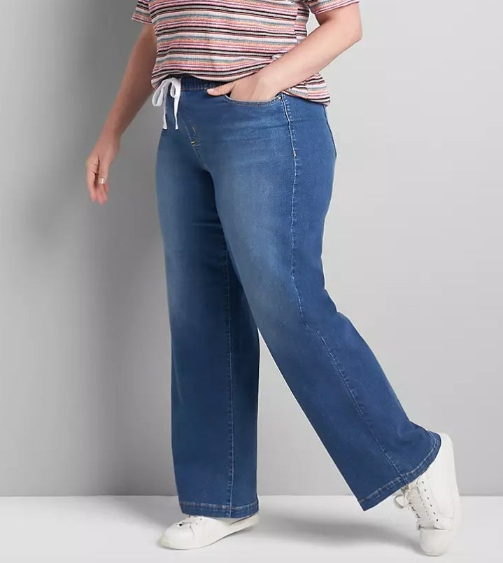Model wearing jeans and striped tee
