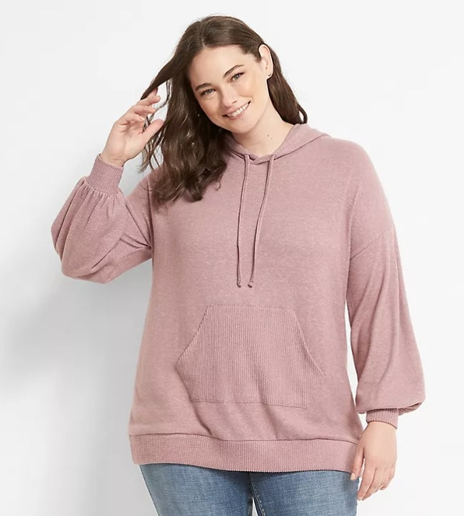 Model wearing a pink hoodie with jeans