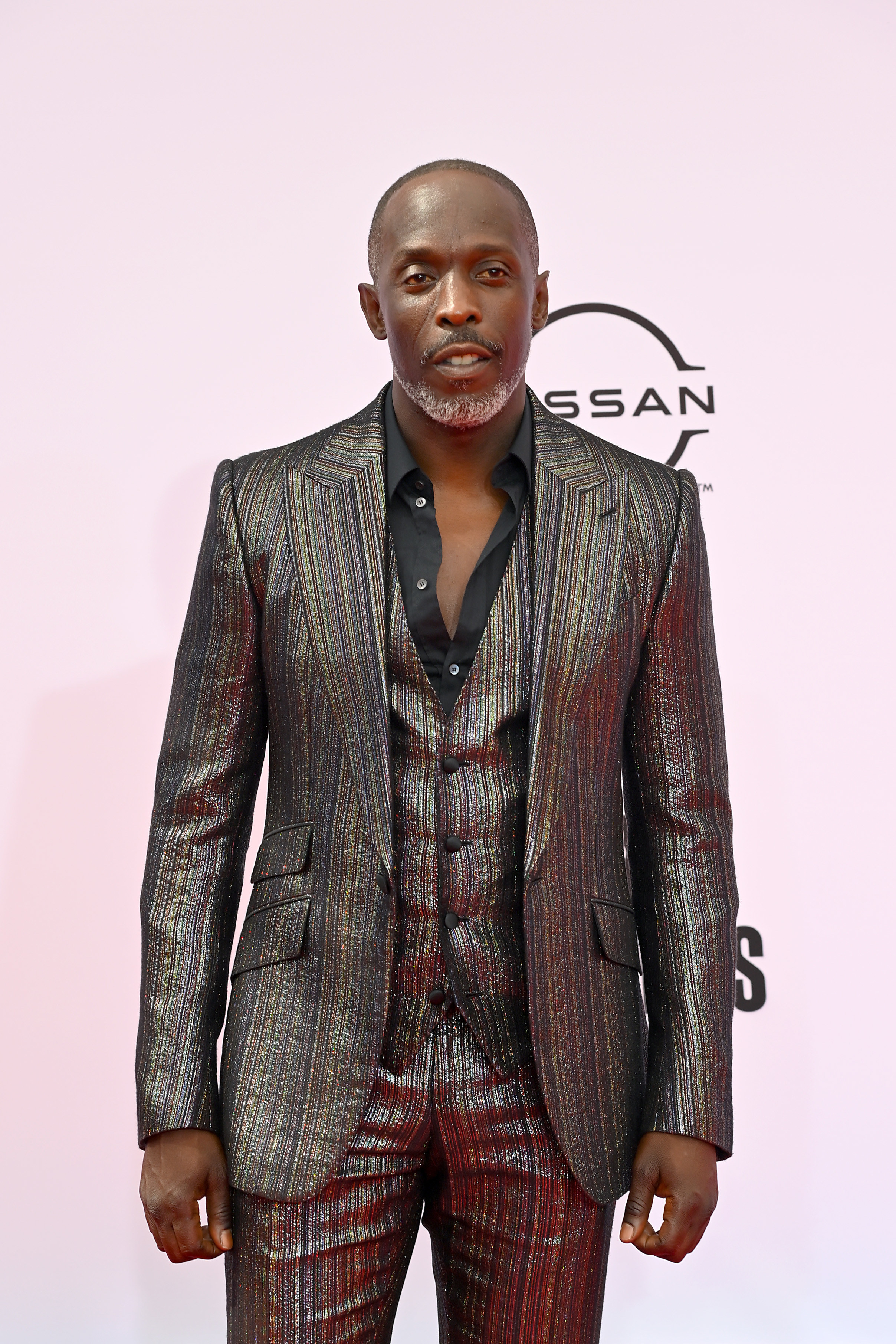 Michael in a textured metallic suit at a red carpet event