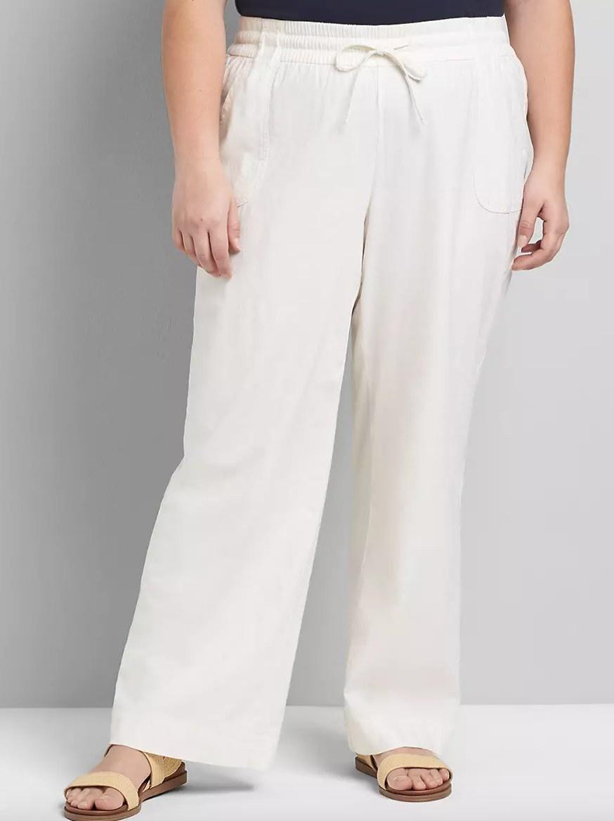 Model wearing white pants