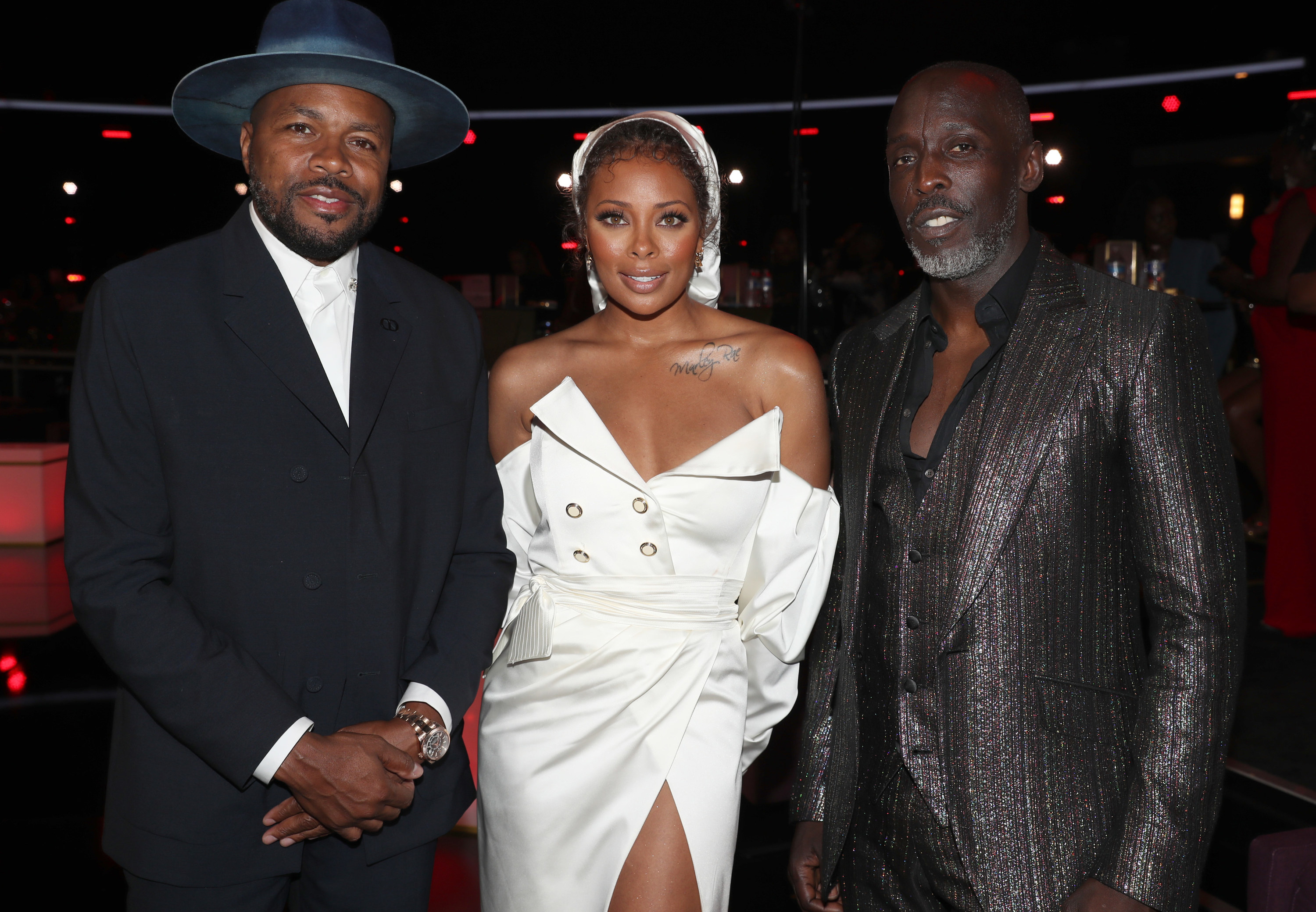 Michael posing for a photo with Eva Marcille