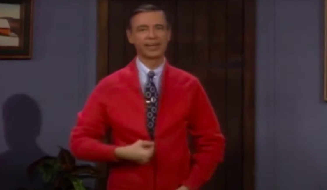 Fred Rogers wearing a red sweater on his show