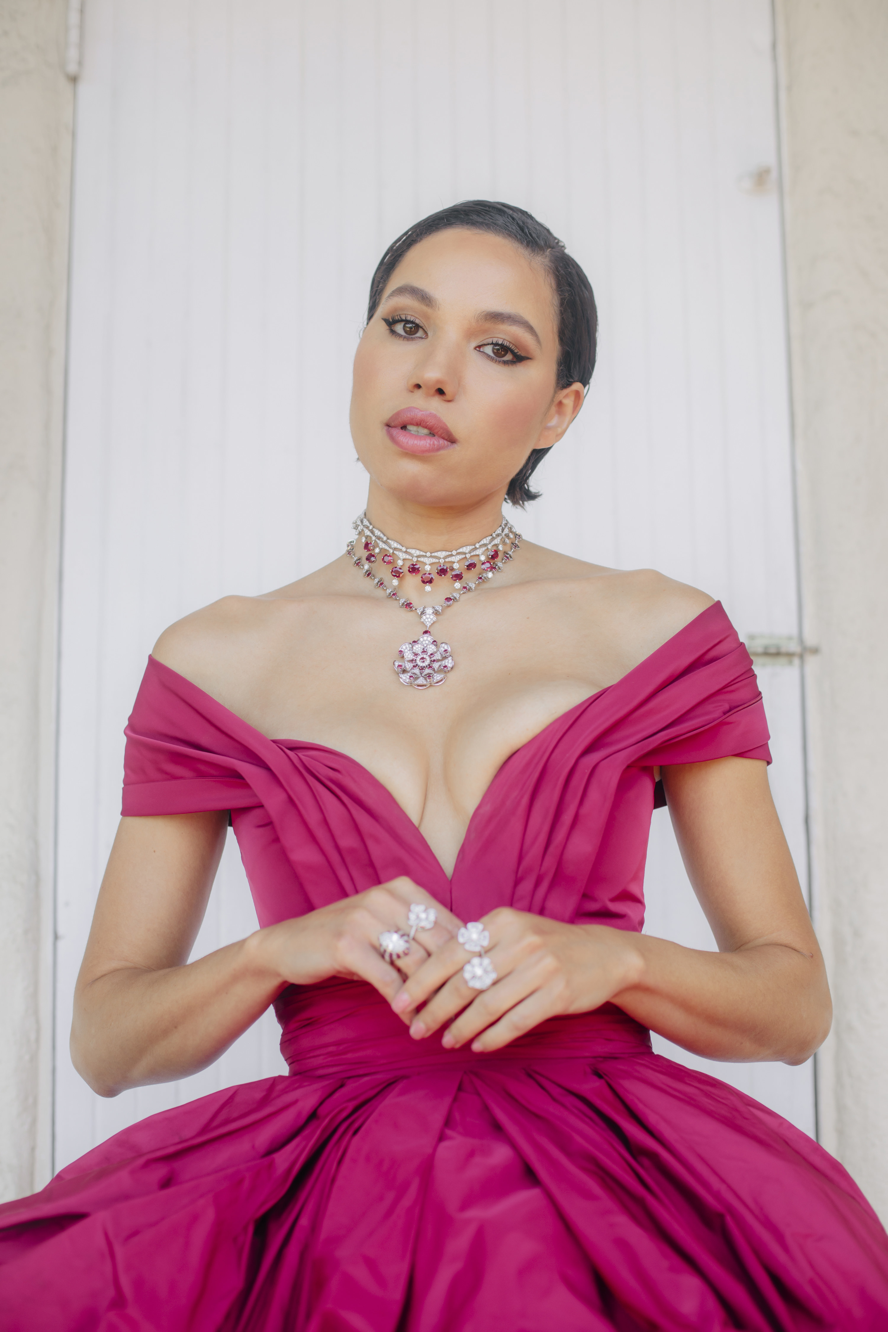 Jurnee posing for a photo in a structured off-shoulder gown