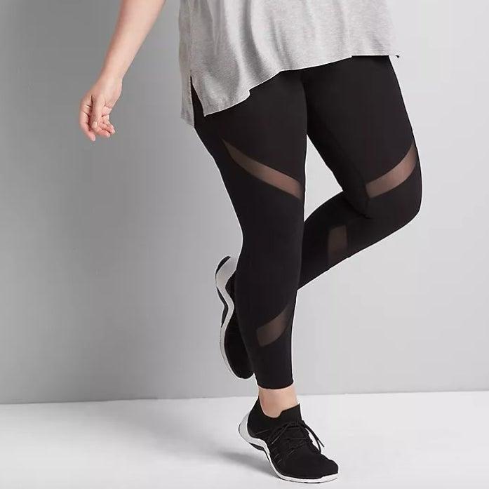 Model wearing grey tee with black leggings