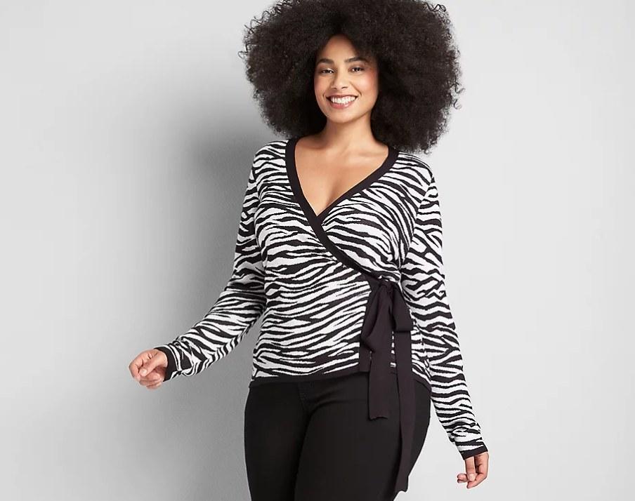 Model wearing zebra top with black pants
