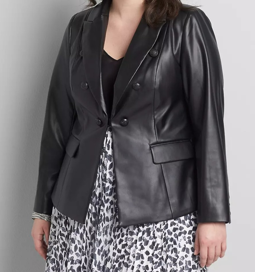 Model wearing leather blazer over a dress