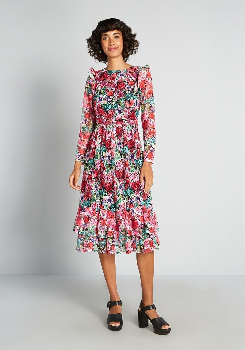 model wearing the long-sleeved pink floral midi dress