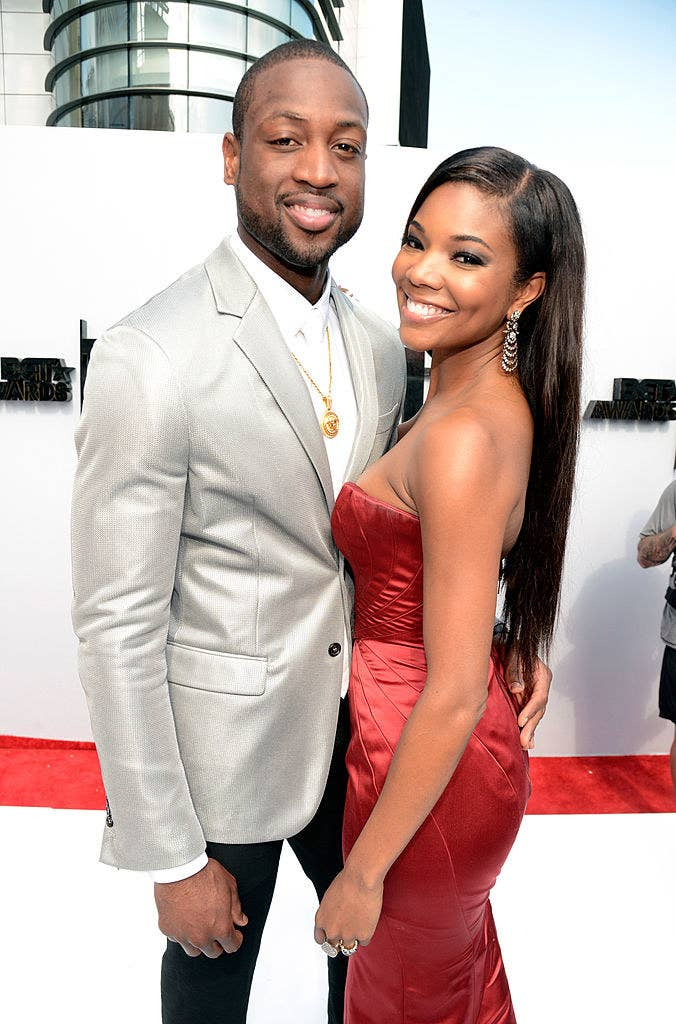 The couple posing on a red carpet