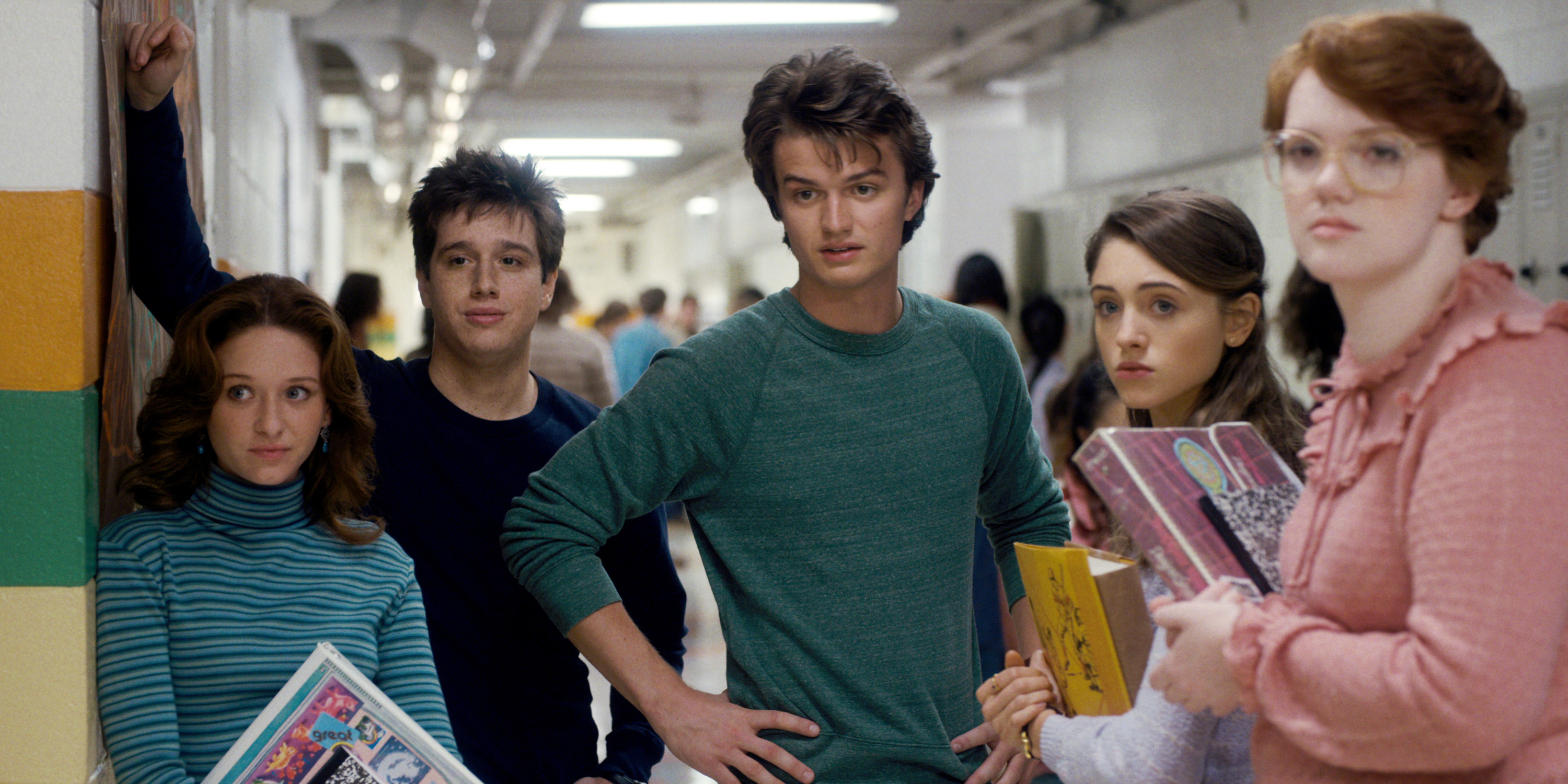 Steve standing surrounded by his friends in Season 1