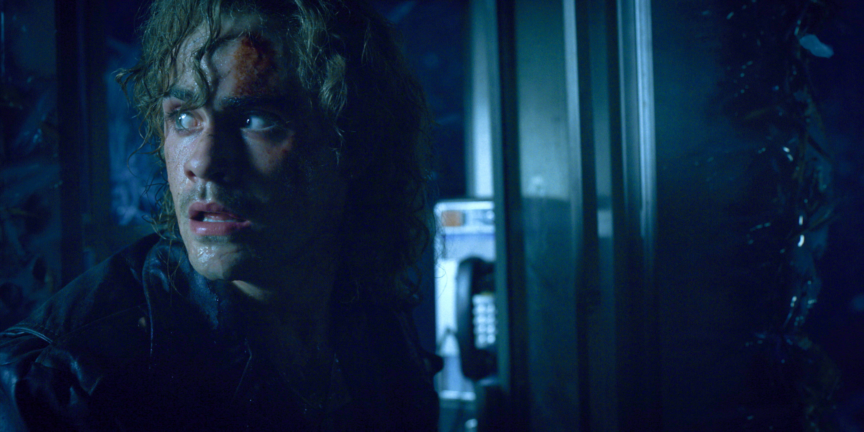 Billy in a phone booth looking panicked