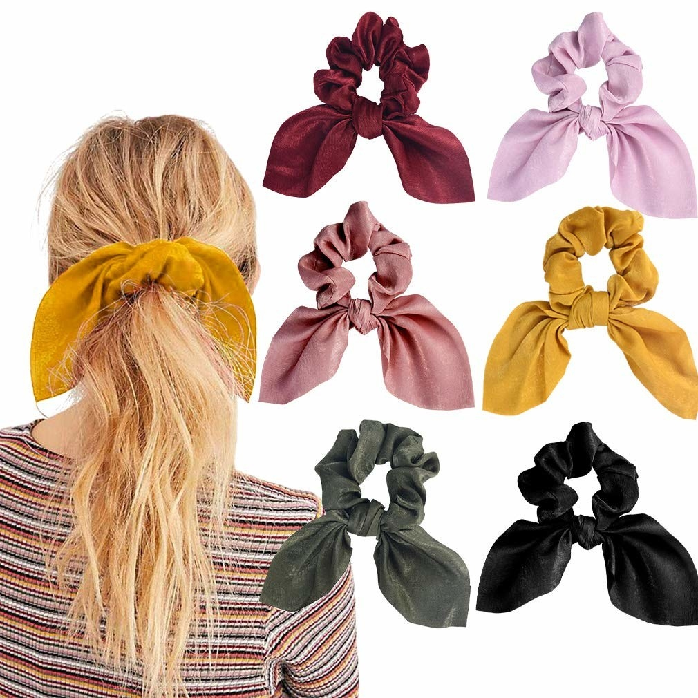 a model wearing a mustard hair scrunchie