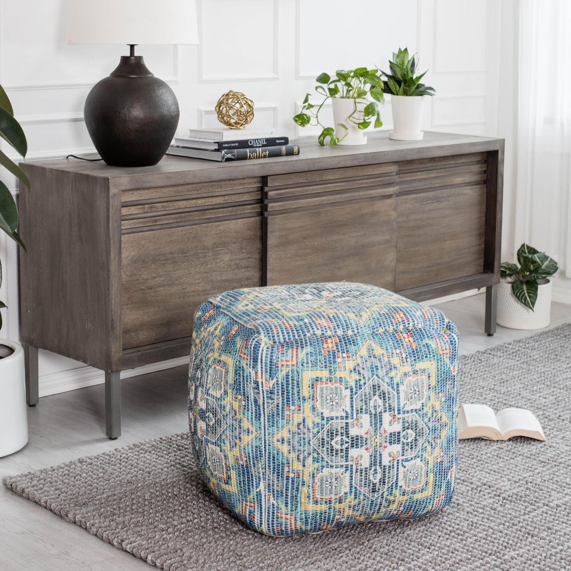 The pouf on the floor in a living room