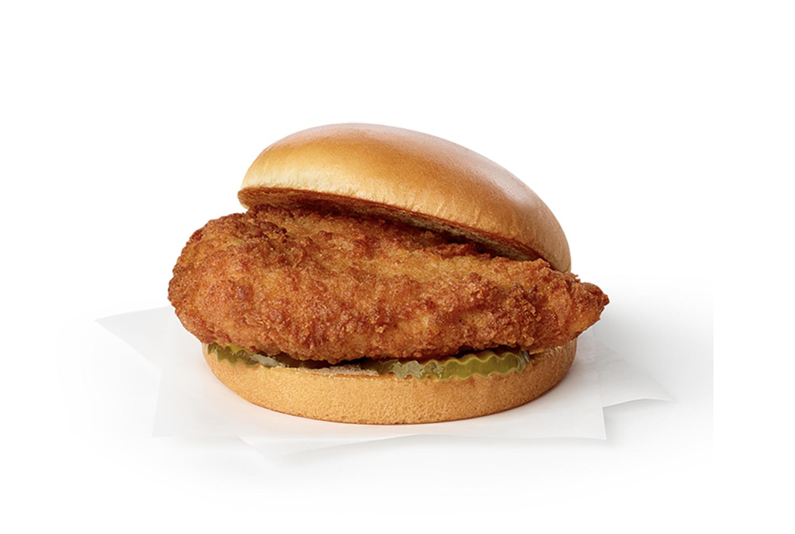 A chicken sandwich with pickles