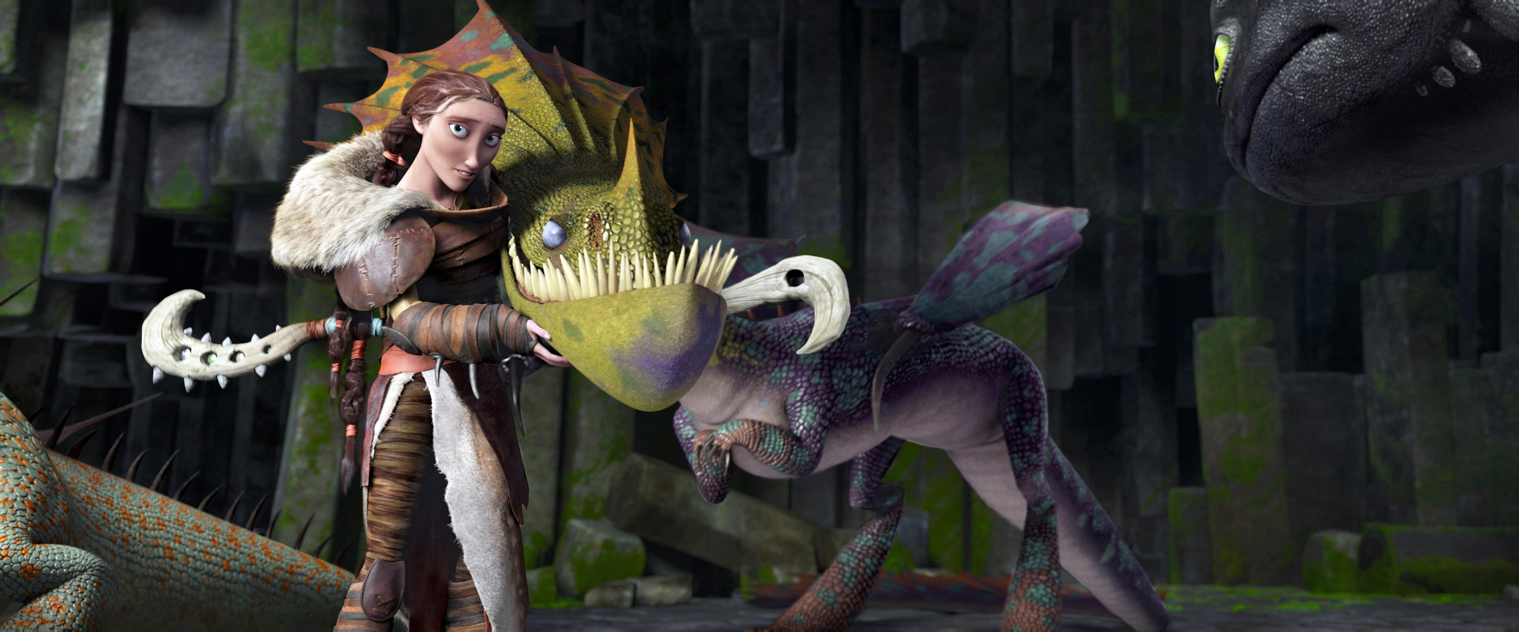 Valka standing with a dragon