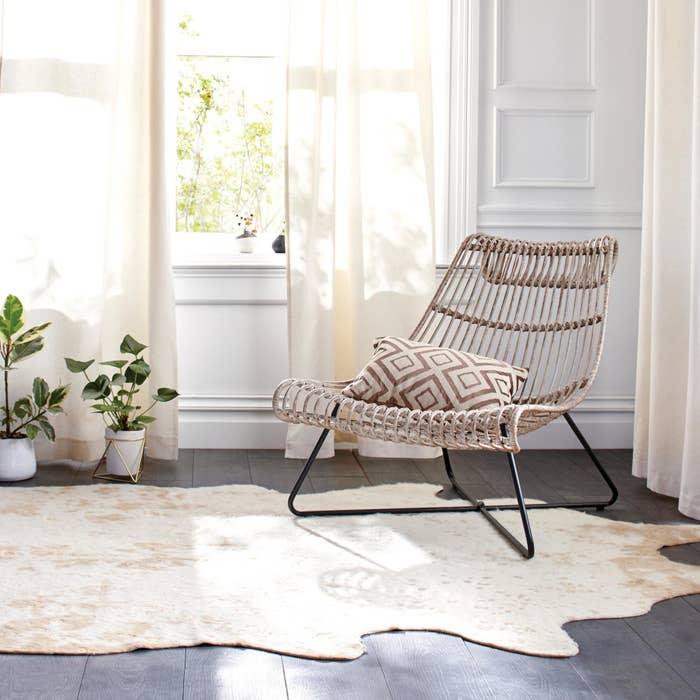 The rug over hardwood floor in a room