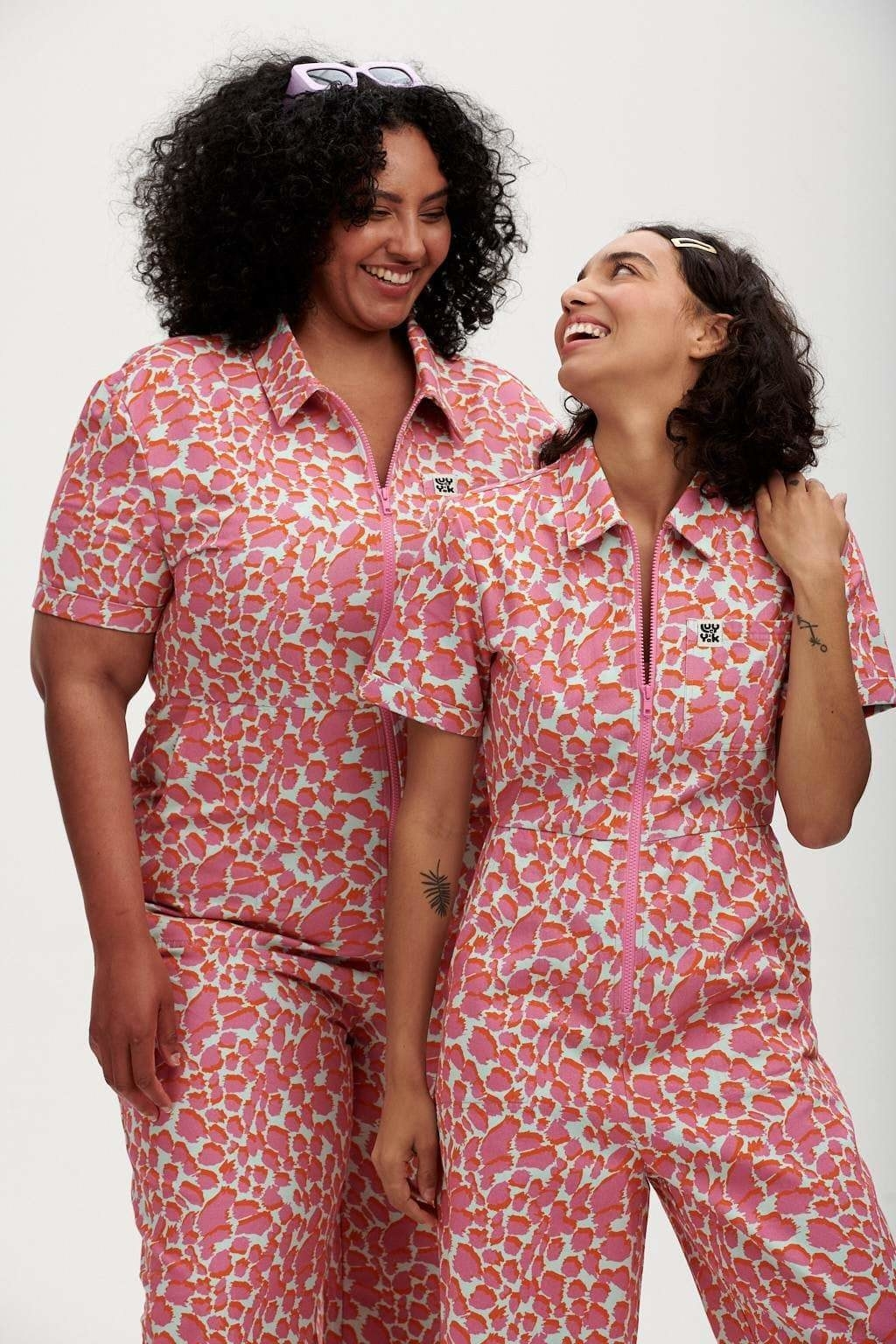 a size 10 and a size 22 model wearing the L.E Ragan boilersuit