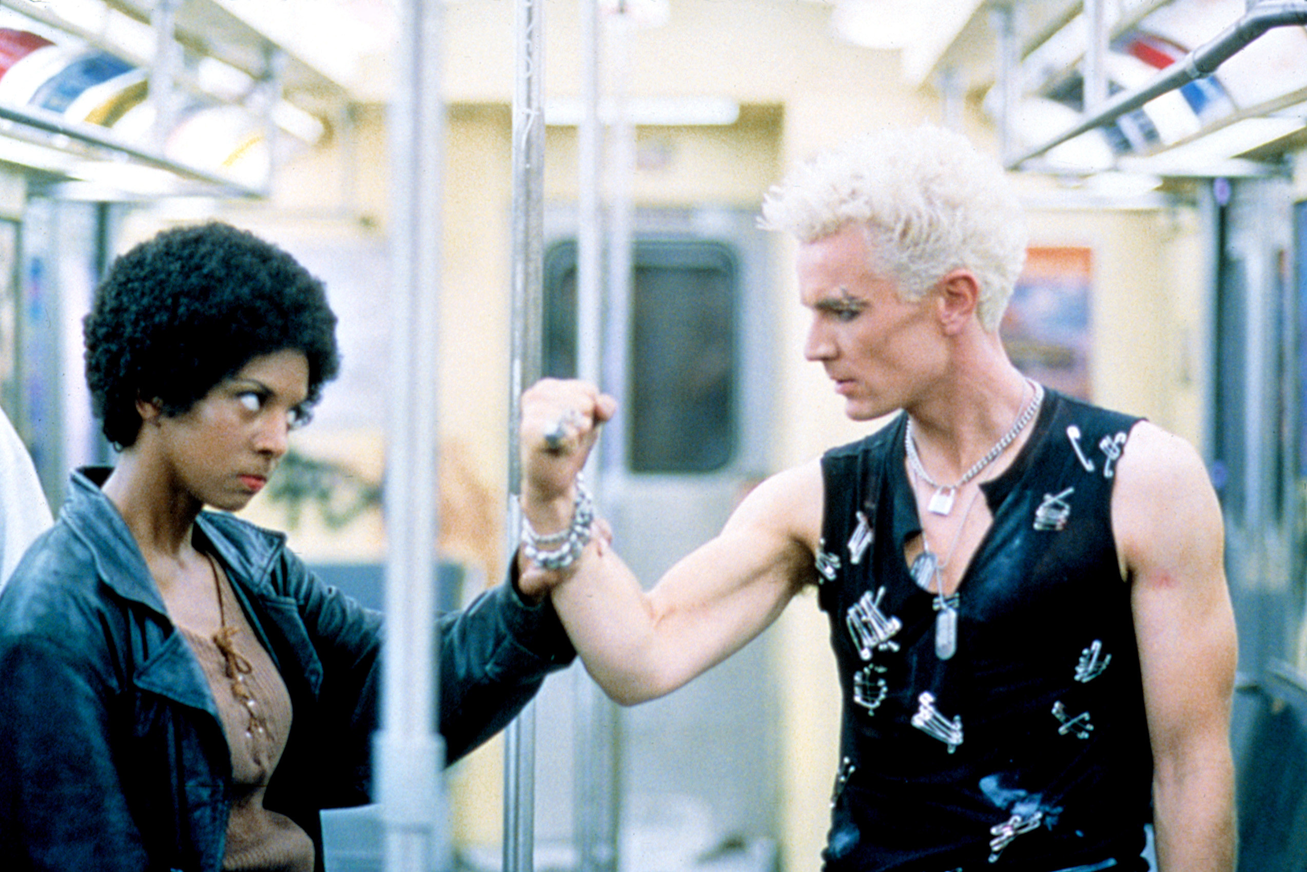 Spike fights a slayer in a subway car