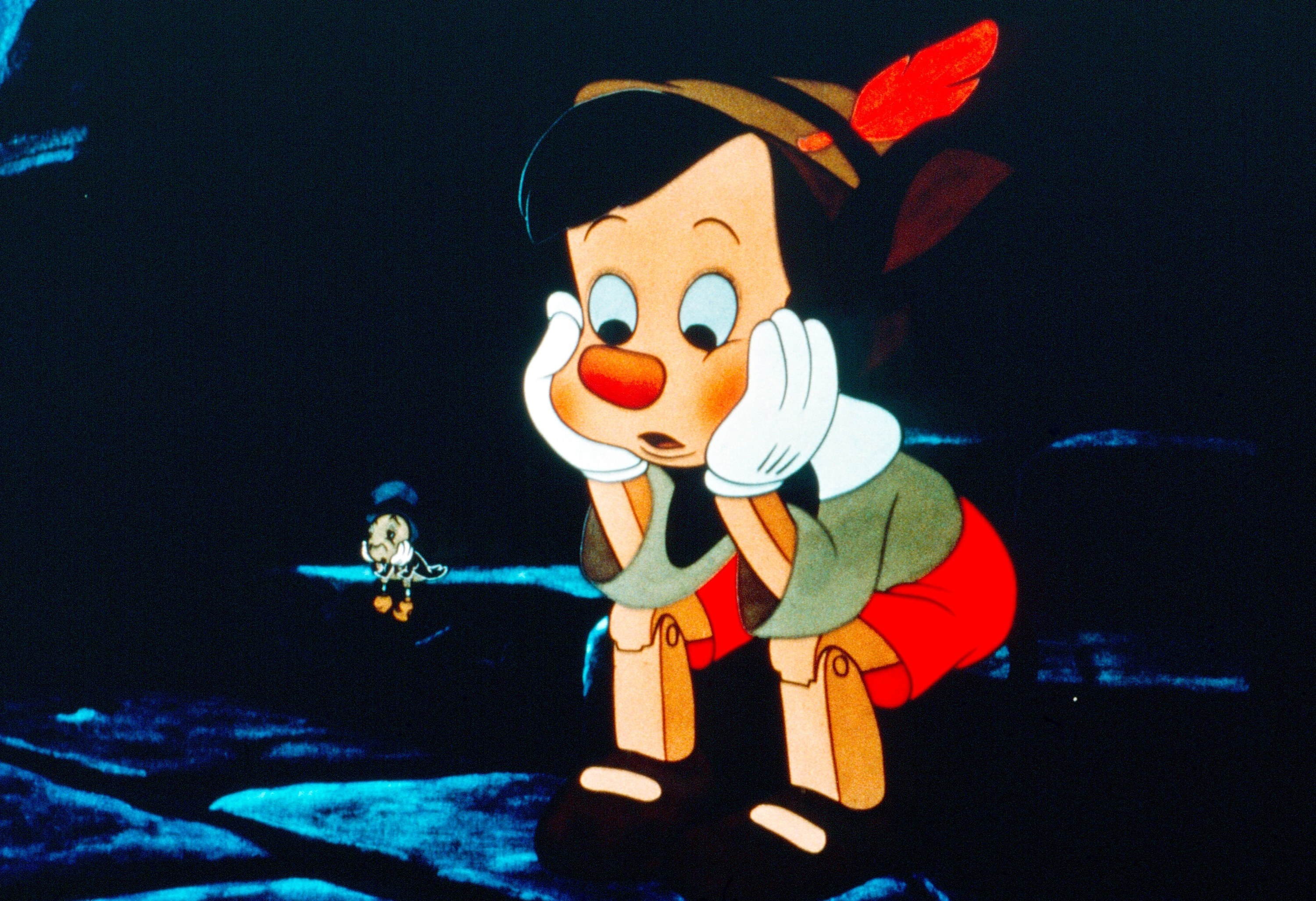 Pinocchio and Jiminy Cricket looking sad together