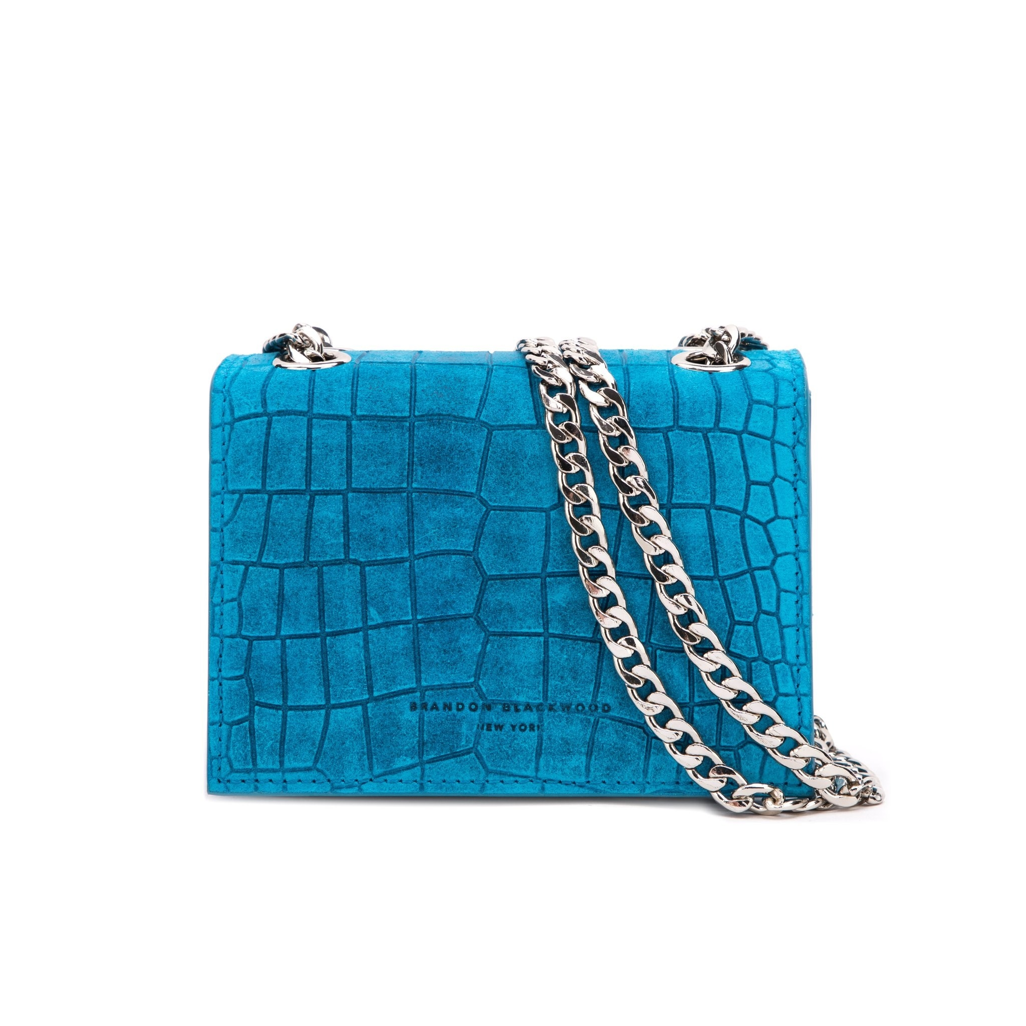 Aqua croc purse on white background