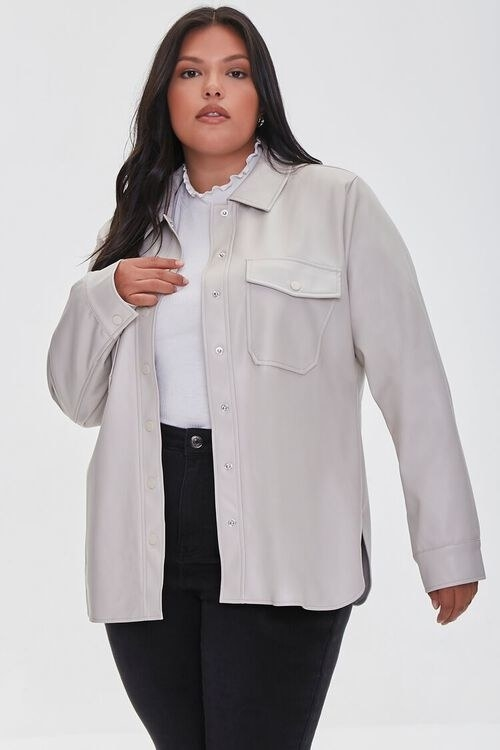 model wearing the beige faux leather shirt