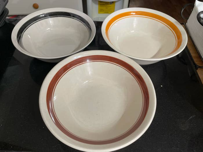 Ceramic bowls with colored rings inside of them