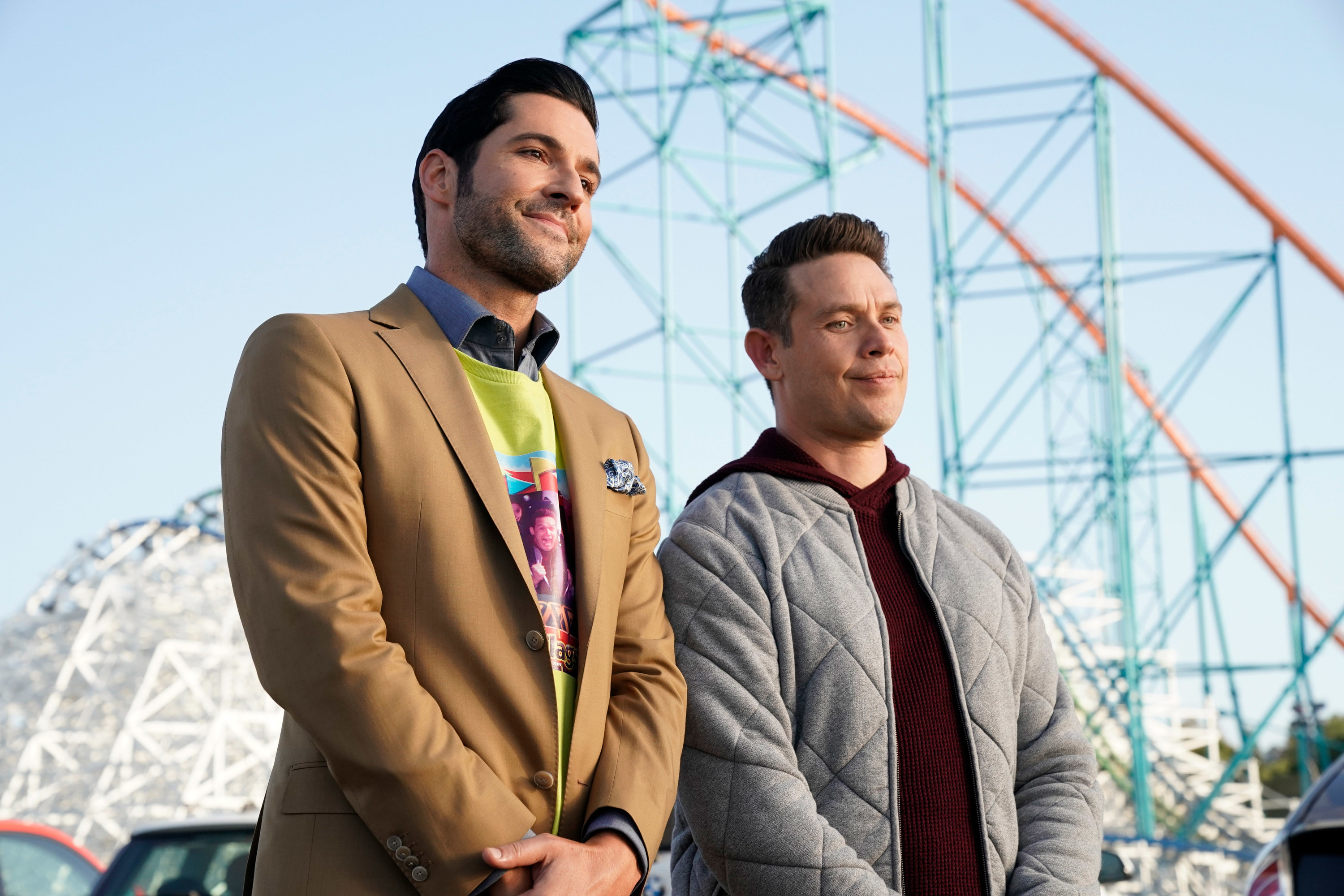 Tom and Kevin standing next to one another at an amusement park