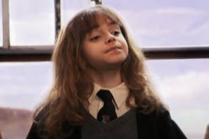 Young Hermione lifting her chin smugly
