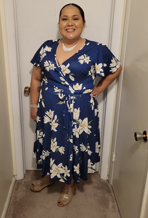 a reviewer photo of the dress in floral and navy