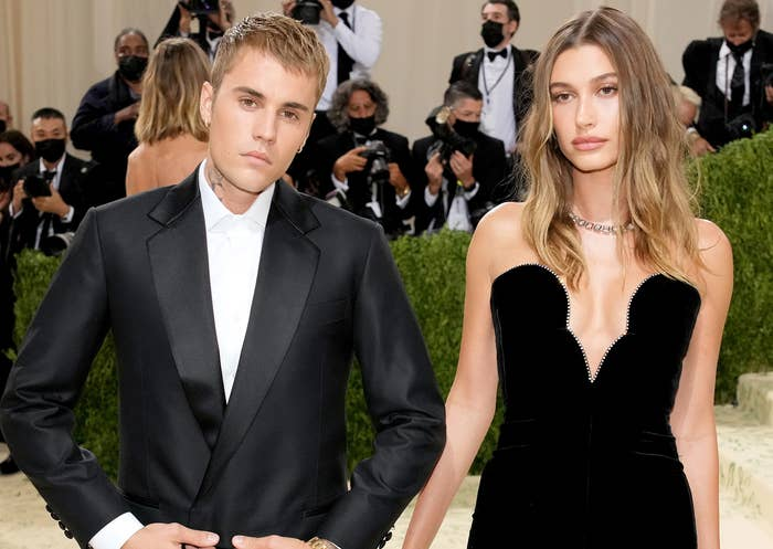 Hailey and Justin stand close together at the event