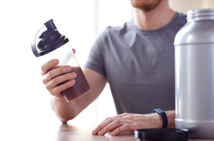Man holding protein shake