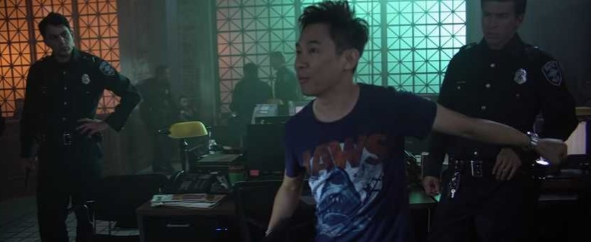 Director James Wan directs actors dressed as police officers