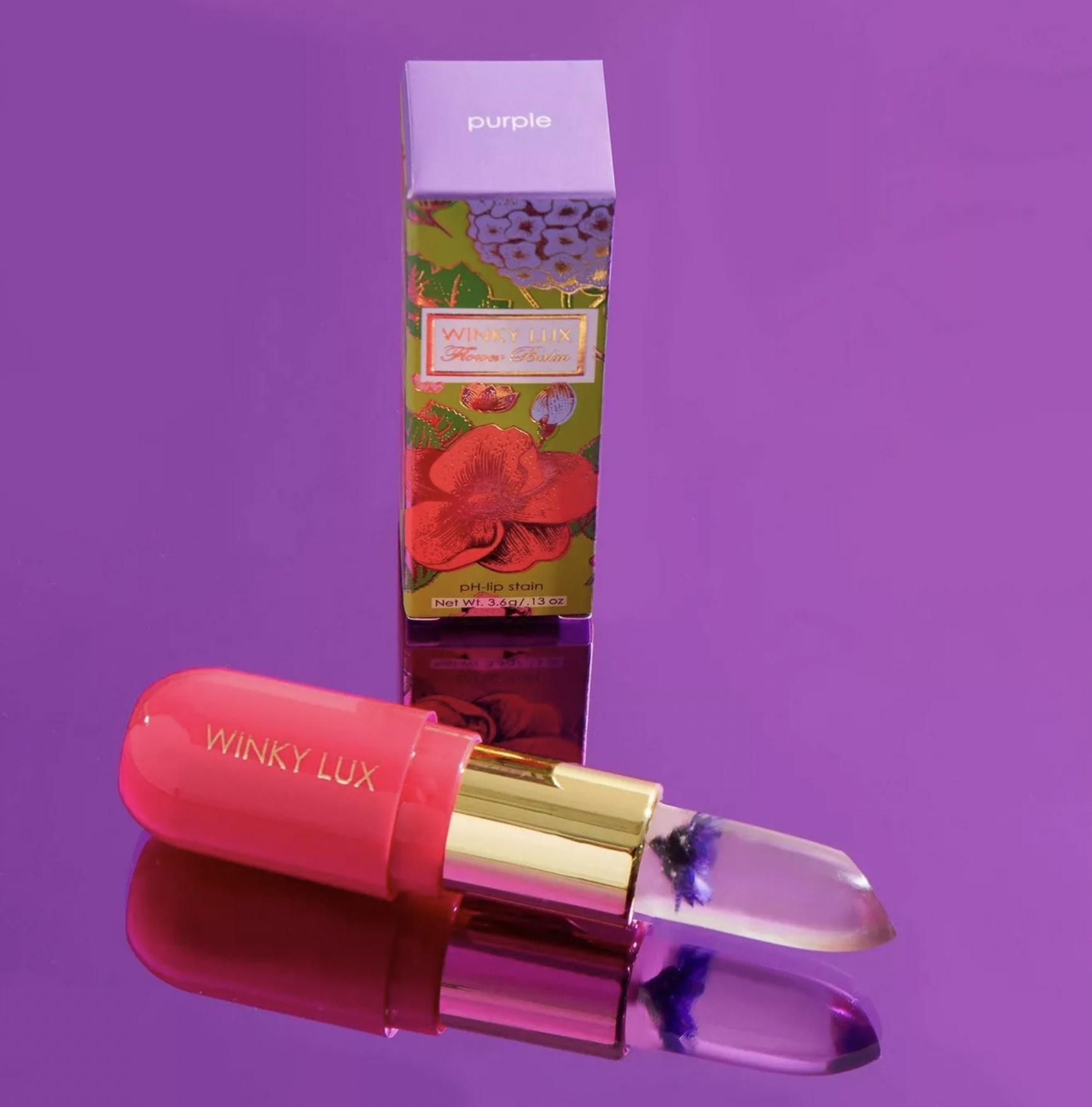 Winky Lux Flower Balm Lip against purple background