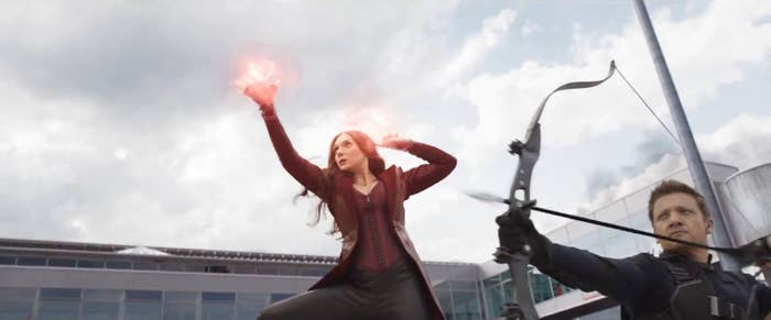Wanda Maximoff shows off a ball of energy in her hands while Hawkeye gets ready to shoot an arrow from his bow