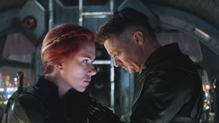 Natasha Romanoff and Clint Barton stand facing opposite of each other