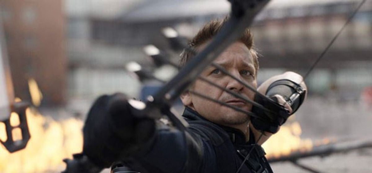 A close up of Clint Barton as he gets ready to shoot three arrows from his bow