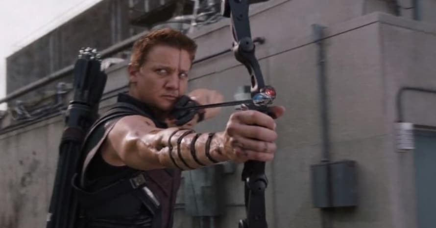 Clint Barton sits perched on a roof top getting ready to shoot an arrow from his bow